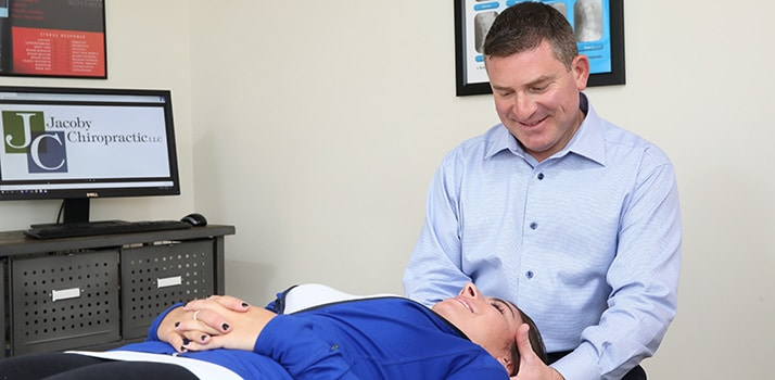 Chiropractor Ridgewood NJ Warren Jacoby Adjusting a Patient